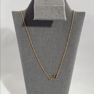 Jewelry - Very simple gold colored cross necklace